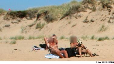 Naken par sex på stranden