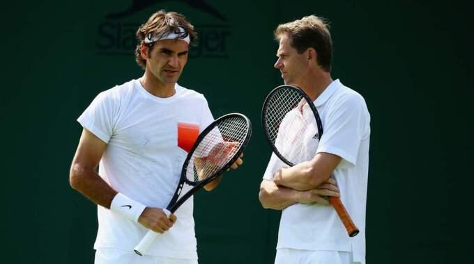 Roger Federer och Edberg. Foto: Al Bello