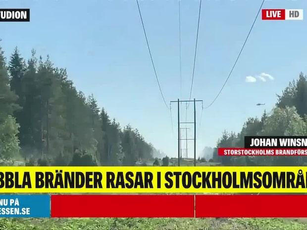 Dubbla bränder rasar i Stockholmsområdet