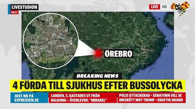 Minst fyra personer till sjukhus efter bussolycka