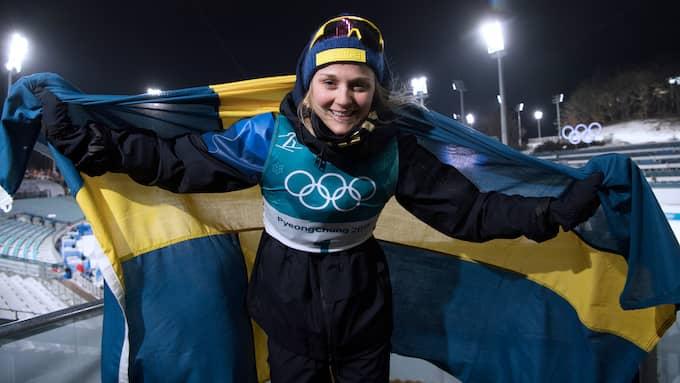 Stina Nilsson jublar efter OS-guldet. Foto: SVEN LINDWALL