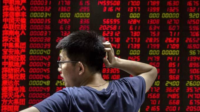 Börsen i Kina stängde efter ett kraftigt ras. Foto: Kevin Frayer