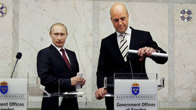 Vladimir Putin med Fredrik Reinfeldt vid ett besök i Sverige. Foto: Robban Andersson